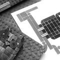 Black and white photo of Lego print blocks and print.
